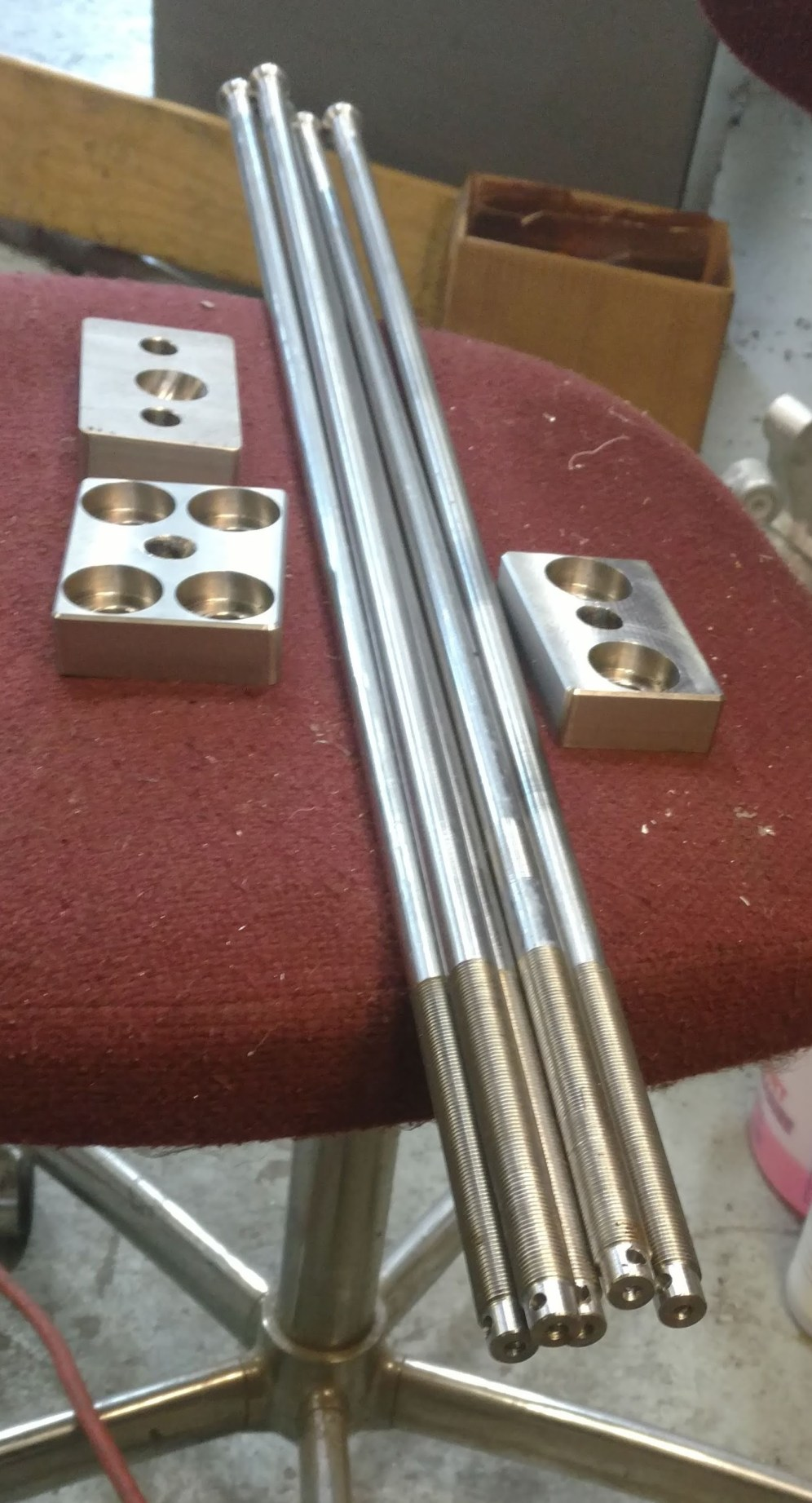 Custome machined chainplate tie down rods and backing plates. Ericson Yachts