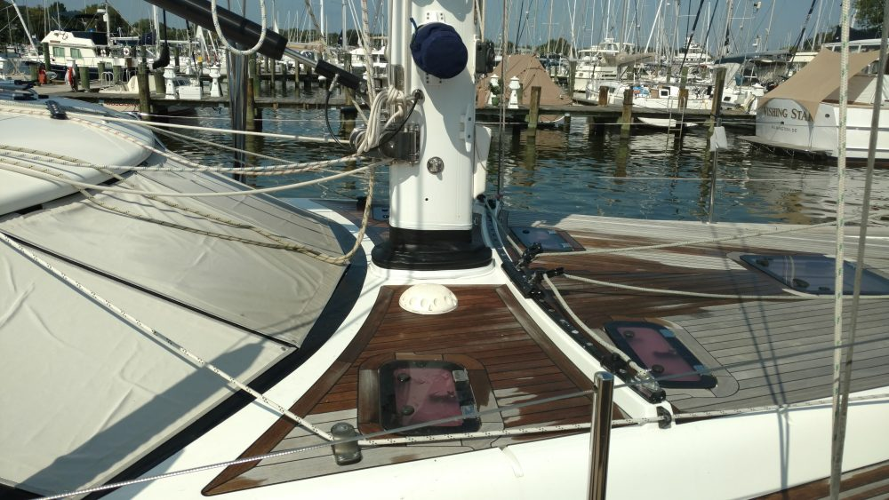 Even new boats can have their issues. New mast boot to replace the factory one that leaked. It's all in how you install it! Discovery 56