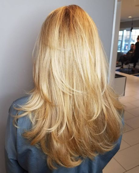 Long Layered Strawberry Blonde Hairstyle