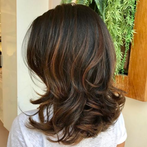 Wavy Layered Brunette Hairstyle With Caramel Highlights