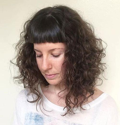 medium tousled waves and short bangs