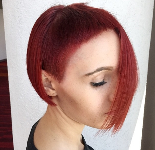 asymmetrical red bob with extra short bangs