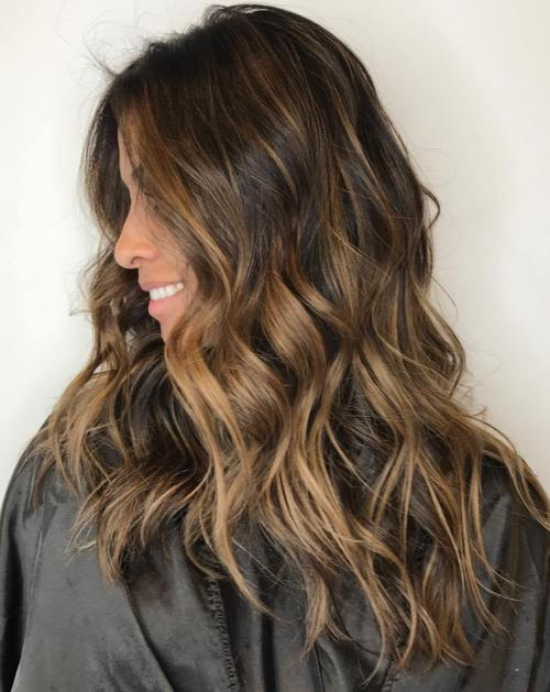 Long Messy Hairstyle With Caramel Highlights