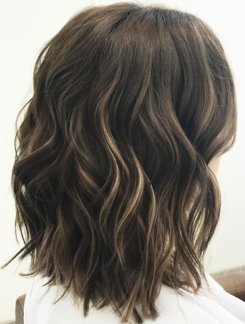 Medium Wavy Brunette Hairstyle