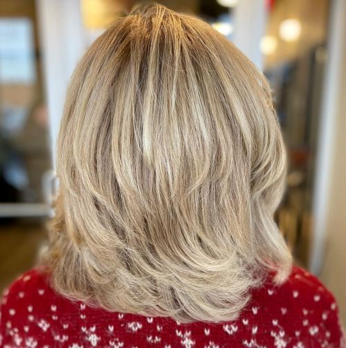 Medium Shaggy Wispy Haircut For Thick Hair