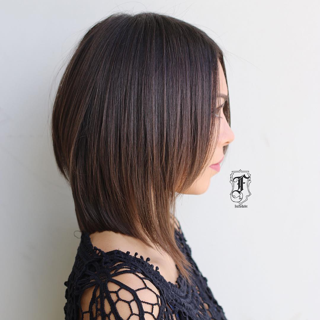 medium length bob with layers and side swept bangs