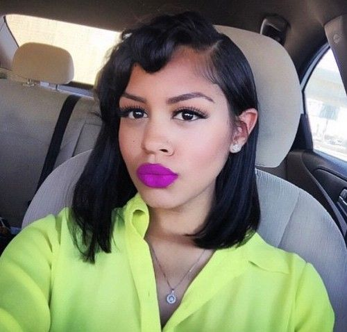 black lob hairstyle with curled bangs