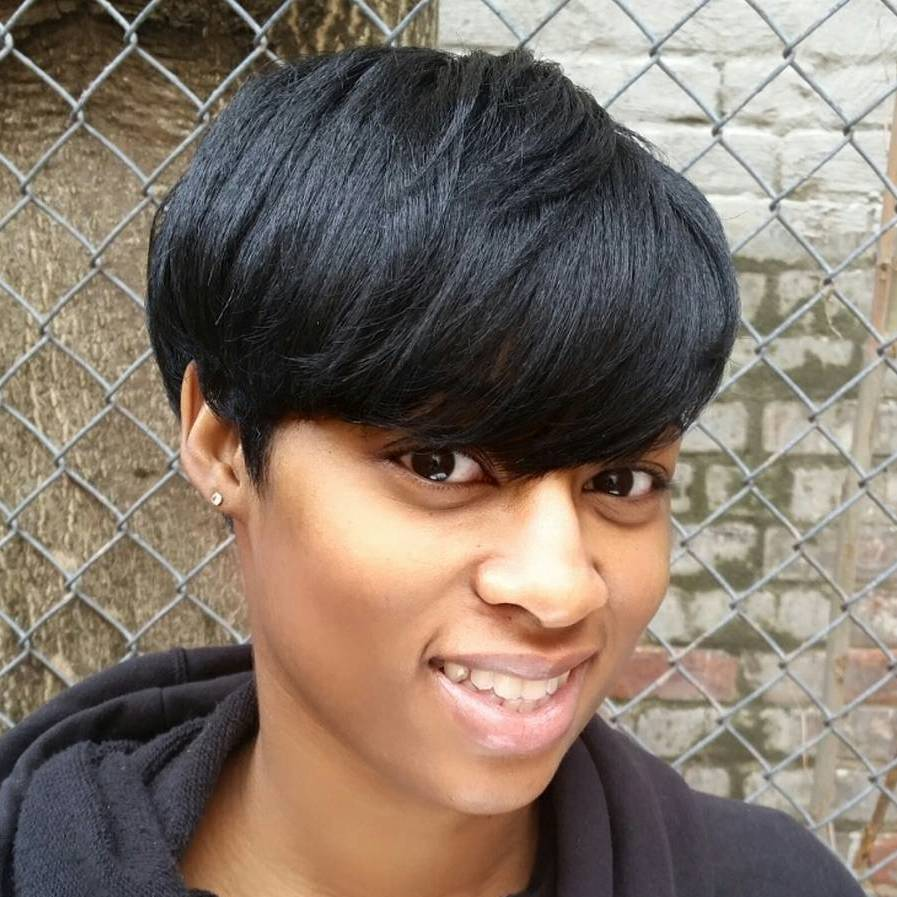 Short Black Haircut With Bangs