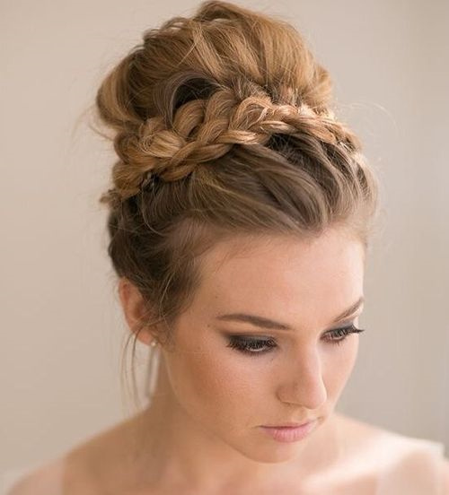 messy prom hairstyle with braid around