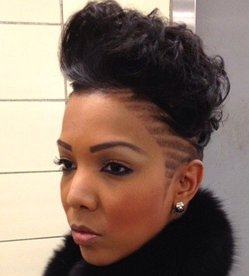black curly mohawk with side shaven designs