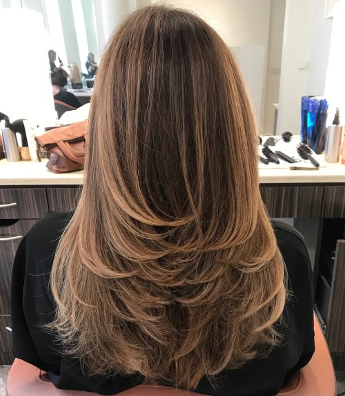 Long Haircut With Feathered Layers And Highlights