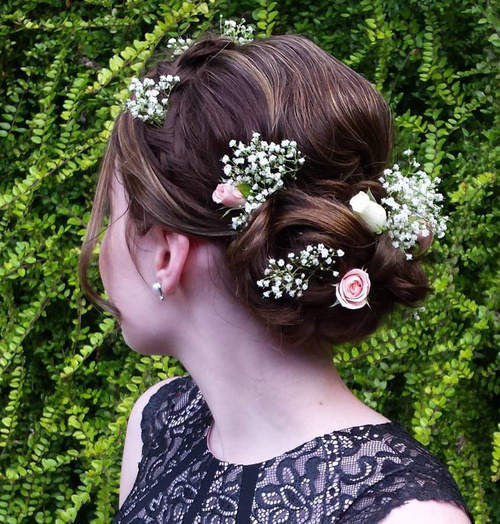 simple updo with hair flowers