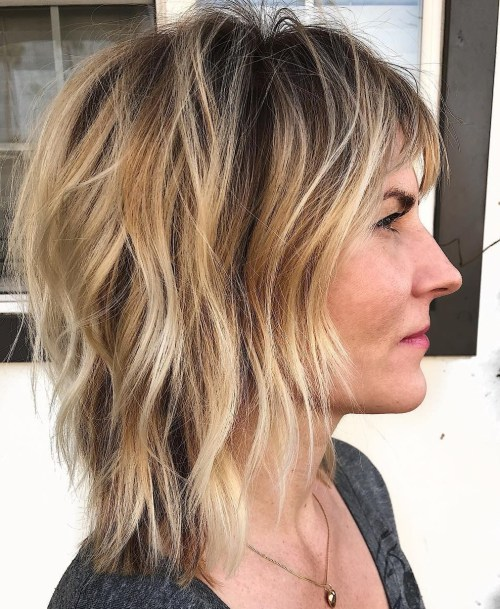 Medium Shag With Bangs And Blonde Highlights