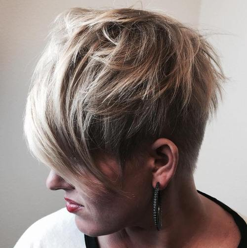 short sassy angled haircut with long bangs