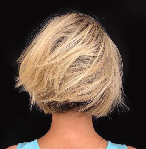 Dynamic Tousled Blonde Bob With Dark Underlayer