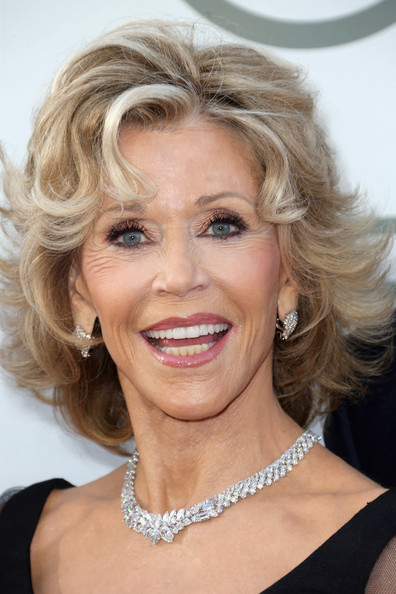 Jane Fonda layered hairstyle with curly bangs