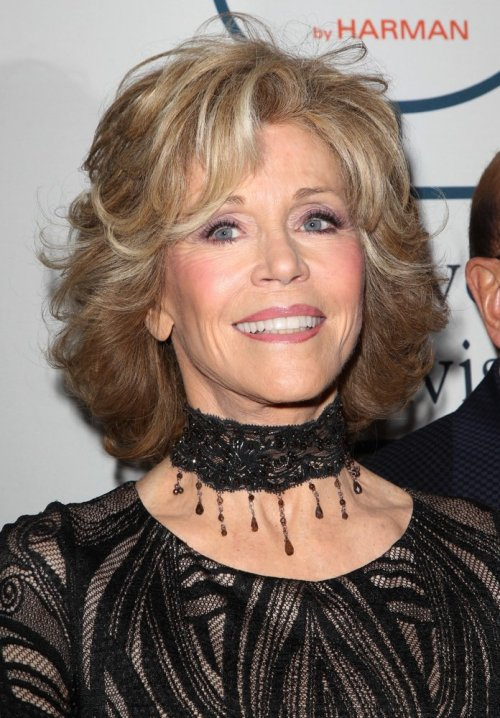 Jane Fonda medium hairstyle with bangs and highlights