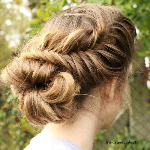 loose messy fishtail and bun updo