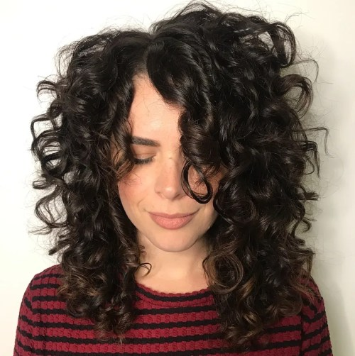 Mid-Length Curly Hairstyle with Off-Centre Part