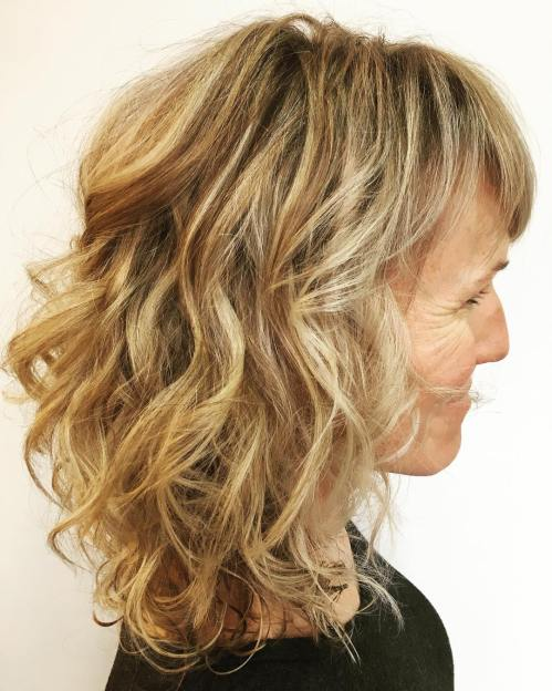 Medium Curly Hairstyle With Bangs
