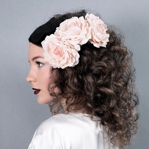 medium curly hairstyle with hair flowers