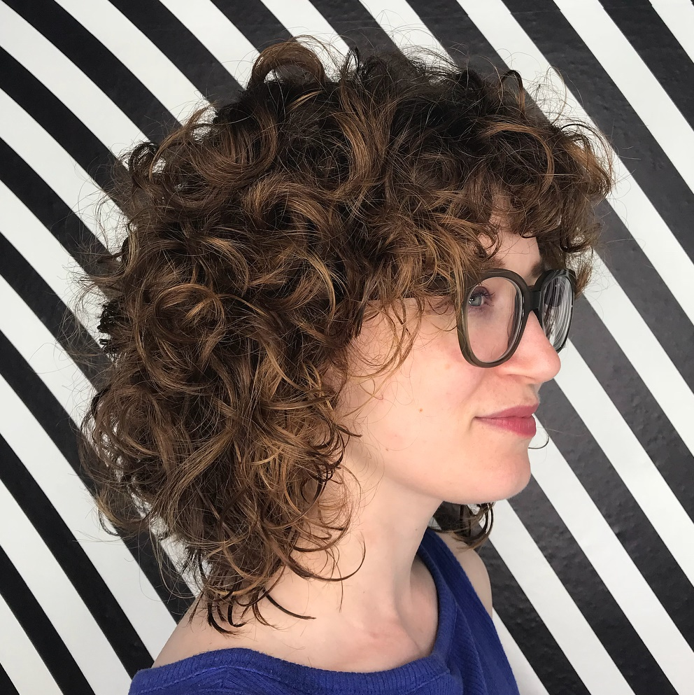 Medium length curly hair with short layers