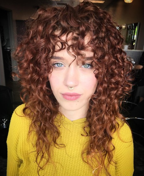 Long Layered Curly Haircut With Bangs