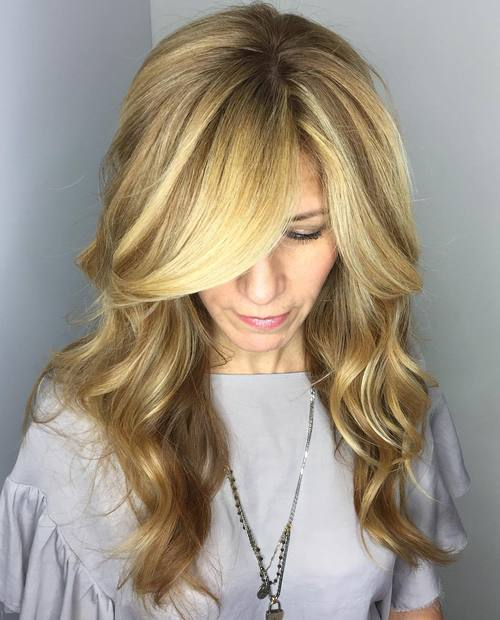 Long Wavy Blonde Hairstyle With Side Bangs