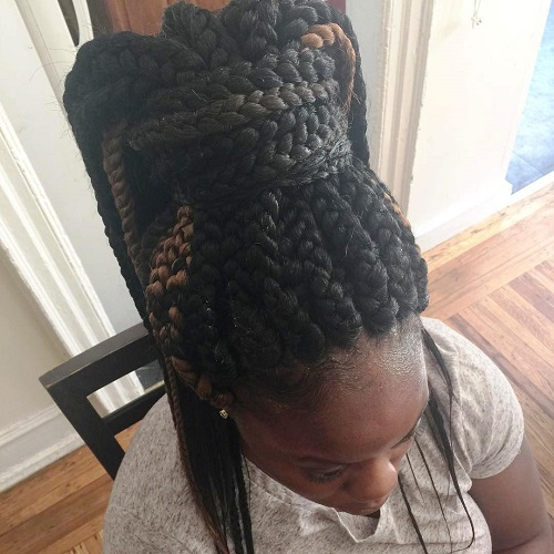 big box braids in a chunky high ponytail