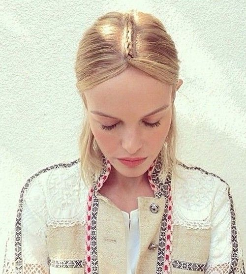 mid-length hairstyle with a braided centre part