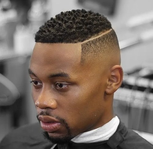 cool fade haircut for black men with a shaved part