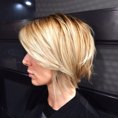 blonde angled shaggy bob with side bangs
