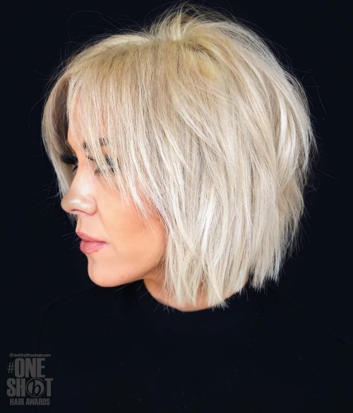 Shaggy Blonde Bob With Long Bangs