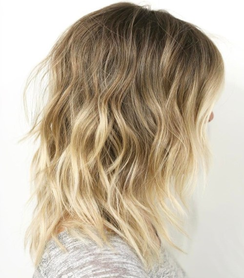 Mid-Length Wavy Blonde Layered Hair