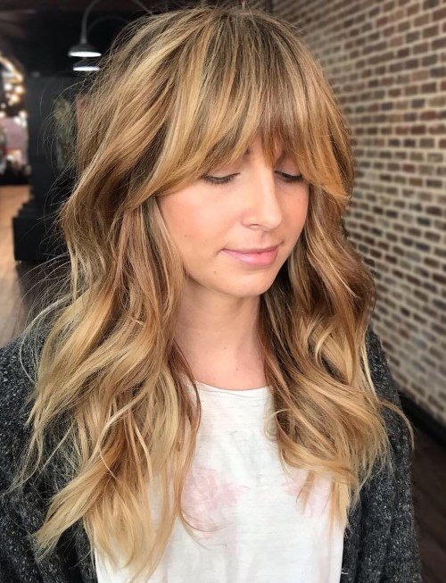 Wavy Shaggy Hairstyle With Bangs