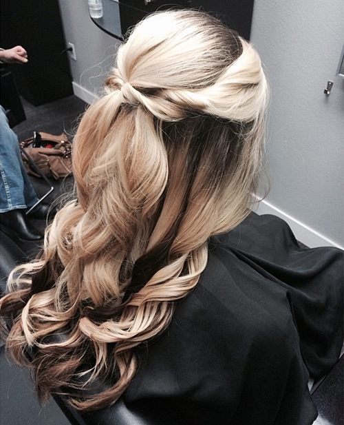 half up curled formal hairstyle for long hair
