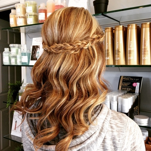wavy half up half down hairstyle with a braid