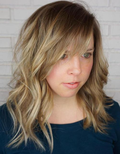 Mid-Length Wavy Hairstyle With Bangs