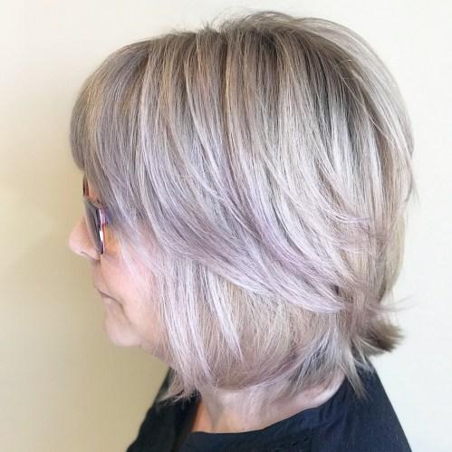 Medium Feathered Ash Blonde Hairstyle