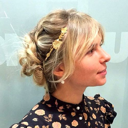twisted updo with bangs for medium hair