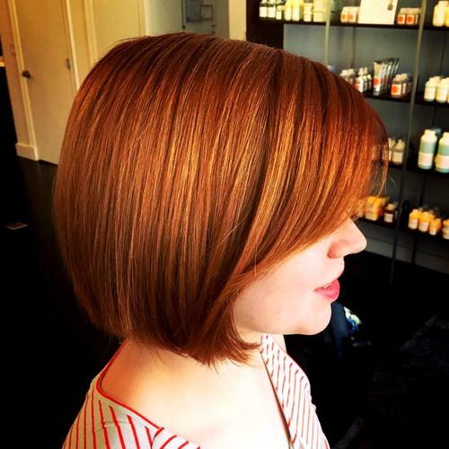 red blunt bob with side bangs