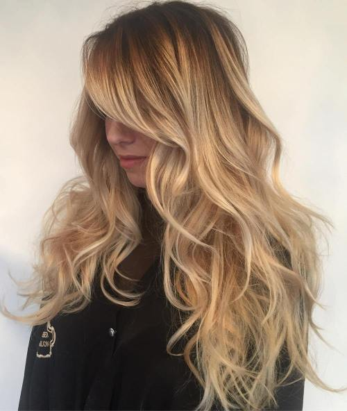 Caramel Blonde Layered Hair With Side Bangs