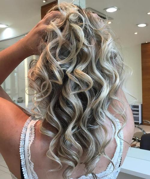 medium curly ash blonde hairstyle