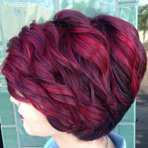 short layered hairstyle with burgundy highlights