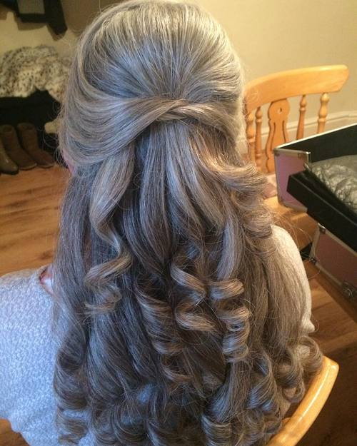 curly formal half updo for women over 60