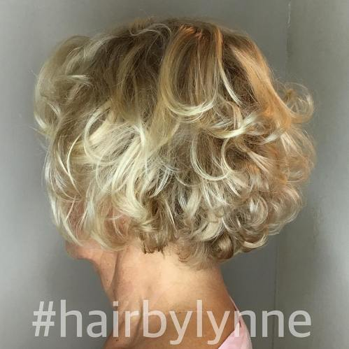 Short Curly Blonde Hairstyle For Over 60