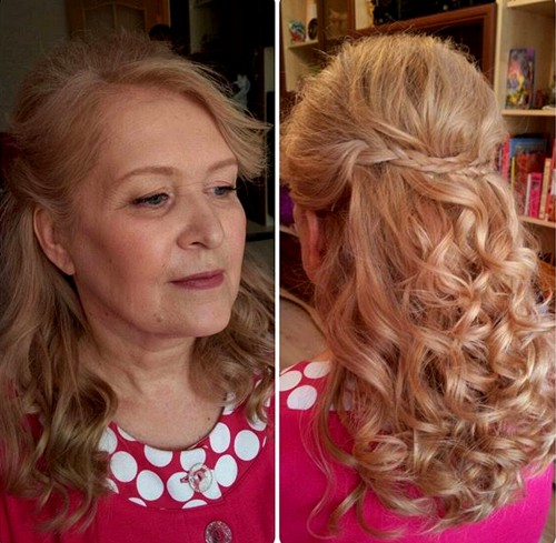 half up curly hairstyle with a braid