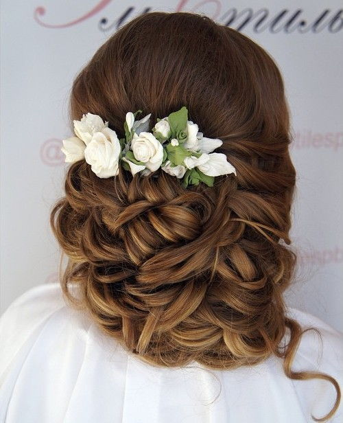 curly wedding updo with flowers for long hair