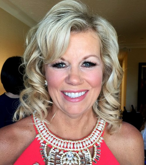 blonde curly mother of the bride hairstyle
