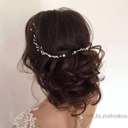 40 chic wedding hair updos for elegant brides loose curly wedding updo urmus Choice Image